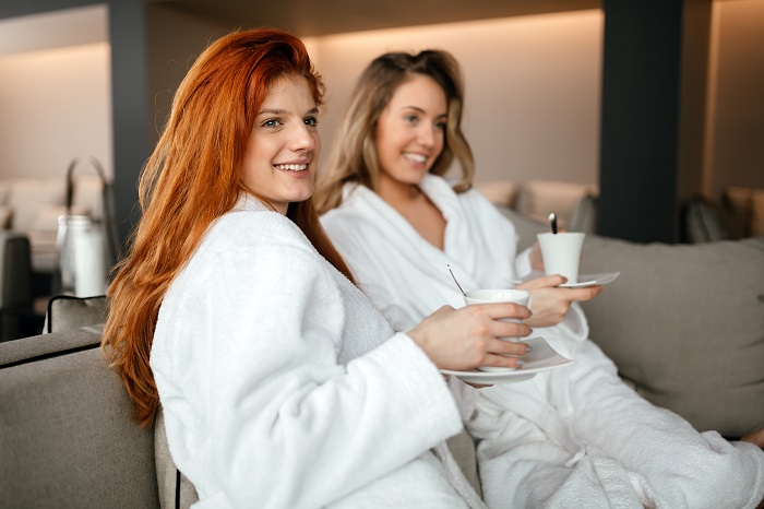 women-enjoying-tea-56SF8VR.jpg